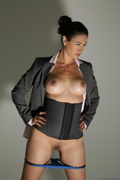Damp and appealing clothed Dana Vespoli is excitingly entrancing off her strict business costume and squats to show..