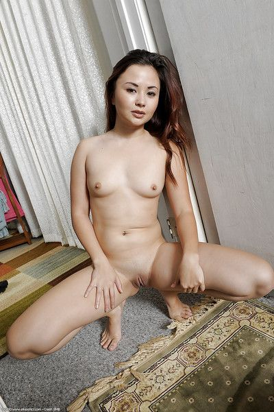 Adolescent Asian lady Kita Zen posing barefoot in wild corset