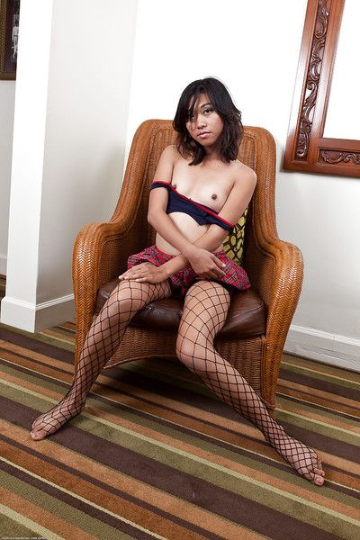 Sprightly Chinese infant in fishnets getting without clothes and exposing her goods
