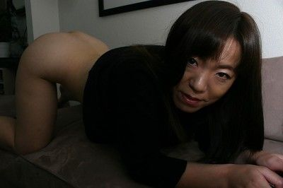 Covered babe Kazue Hamano is revealing her Eastern curly muff in close up