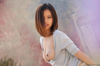 Appealing Chinese babe in fixed jeans Khyanna Song is flashing her faultless standard billibongs exposed