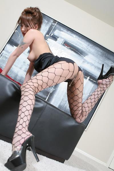 Tattoo pretty Jade Hsu in corset and fishnet pipe takes lenience of powerful dick