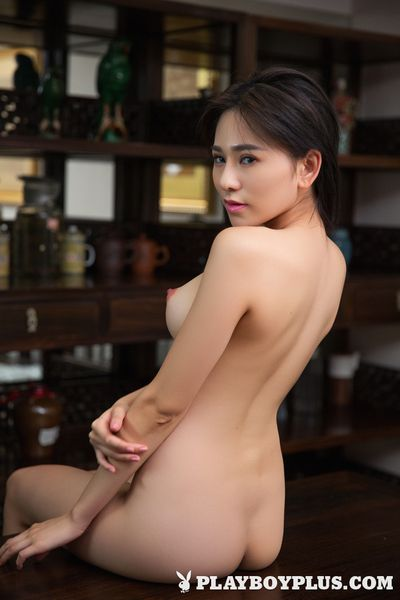 Dark brown Eastern youthful centerfold Wu Muxi posing undressed to show her faultless milk cans
