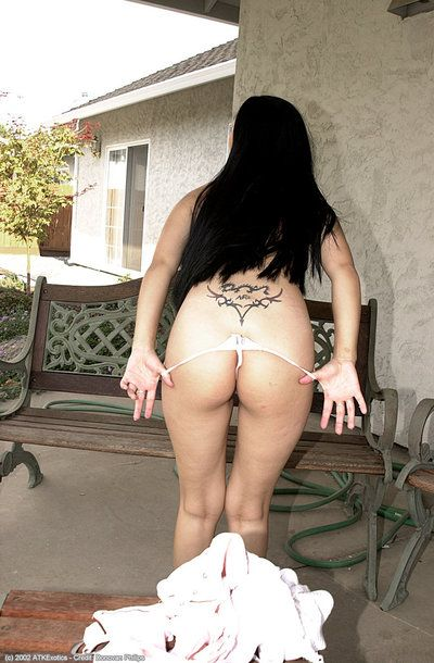 Infant Chinese lady Mariah undressing outdoors to demonstrate shaggy bush