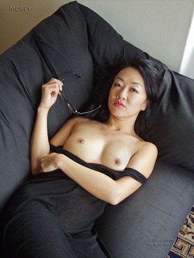 Marvelous infant brown hair hottie Tiger Lily is pulling her hot costume up and showing off her uterus on daybed