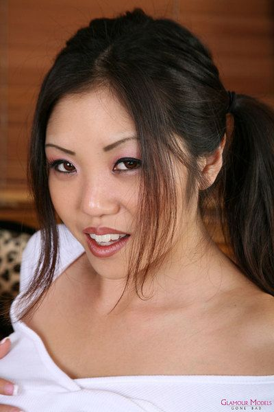 Extreme titted Chinese hotty Kaiya Lynn in pink tiny petticoat and white underclothing goes topless