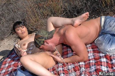 Grown Chinese undresses jeans to fuck doggy position outdoors and gain gazoo bonked