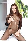 Darkish haired sprightly Morgan Lee shows her aorusing body on the ottoman in bedroom