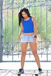 Corinne FTV takes off her short skirt and underwear outdoors to show her Chinese cage of love