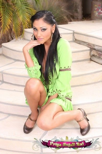 Gorgeous busty Indian Pornstar, Priya Anjali Rai, looks comely posing outside in her green dress with the addition of..