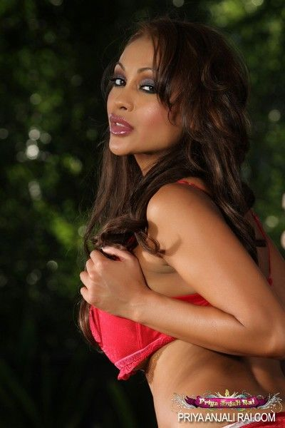 Busty Indian hottie, Priya Rai, gets hot posing outside taking gone her overheated hot and down in the mouth..