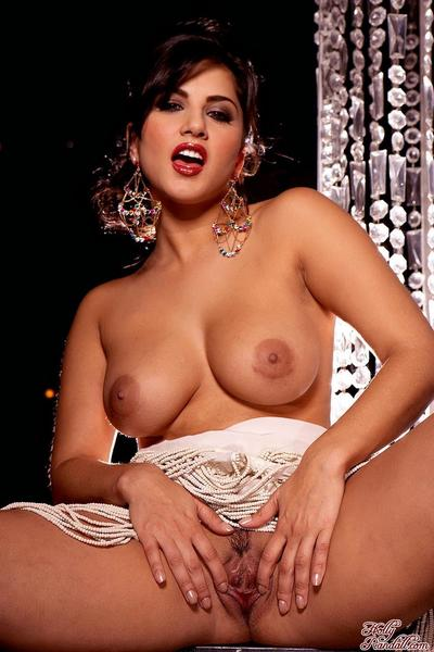 Busty Sunny Leone exposes the brush shaved snatch plus removes the brush beautiful dress