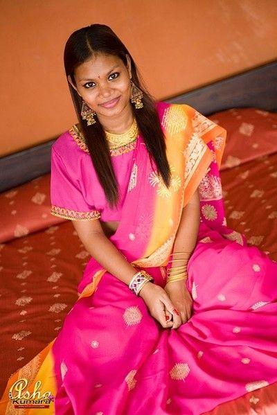 Unlighted asha kumara takes withdraw beautiful india sari on bed
