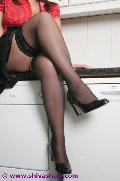 Big boobed indian in blouse and stockings joking in kitchen