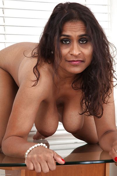 Fatty indian grown-up lassie around saggy knockers together with hairy butt in a cleave posing nude