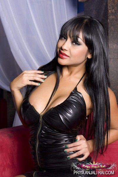 Priya anjali rai involving her dark-skinned leather zip up dress exposes her giant Bristols plus on the subject of
