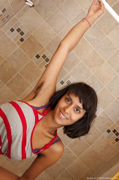 Smoking hot Indian babe with hairy armpits Sonya N stripping in the decontaminate