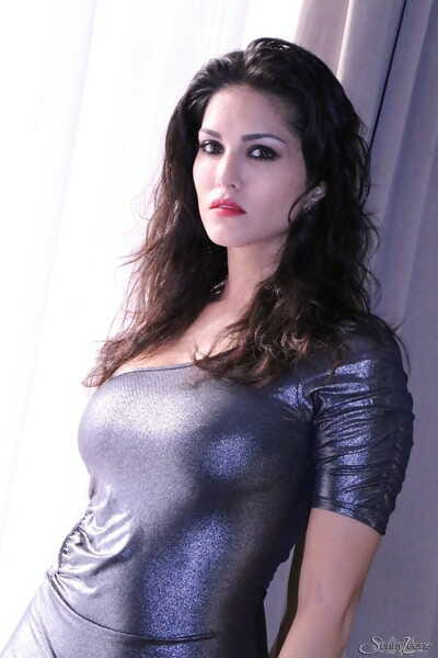 Canadian MILF Sunny Leone frees her big tits and pussy from a tight apparel