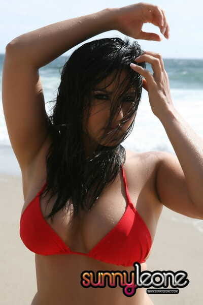 Irresistible pornstar increased by incise Convinced Leone in sexy red dunk suit on the beach
