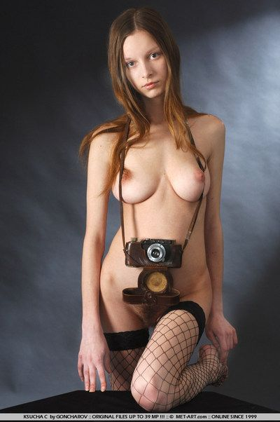 Bawdy energetic titted babe Ksucha C wold net stockings makes all hot shots with her camera